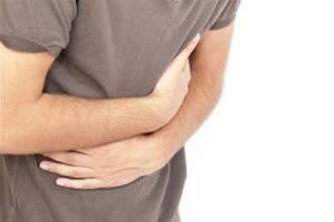Что болит желудок или спина